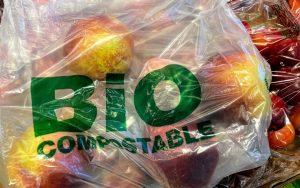 bio compostable plastic bag containing apples