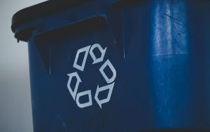 Close up of a blue recycling bin with white recycle logo
