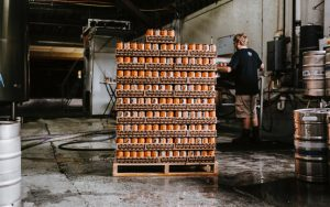 Drinks cans loaded onto a pallet in a warehouse